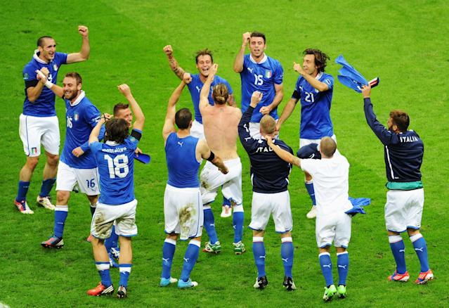 WARSAW, POLAND - JUNE 28: Italy players celebrate victory after the UEFA EURO 2012 semi final match between Germany and Italy at National Stadium on June 28, 2012 in Warsaw, Poland. (Photo by Michael Regan/Getty Images)