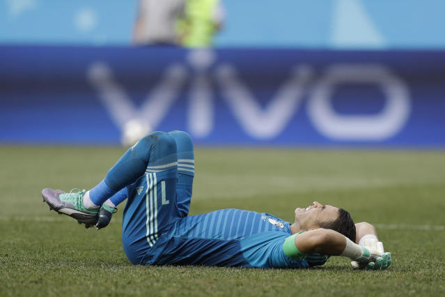 Egypt goalkeeper Essam El Hadary reacts in pain during the group A match between Saudi Arabia and Egypt at the 2018 soccer World Cup at the Volgograd Arena in Volgograd, Russia, Monday, June 25, 2018. (AP Photo/Andrew Medichini)