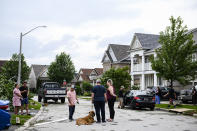 <p>Local residents examine the damage caused by a tornado, in Barrie, Ont., on Thursday, July 15, 2021. THE CANADIAN PRESS/Christopher Katsarov</p>