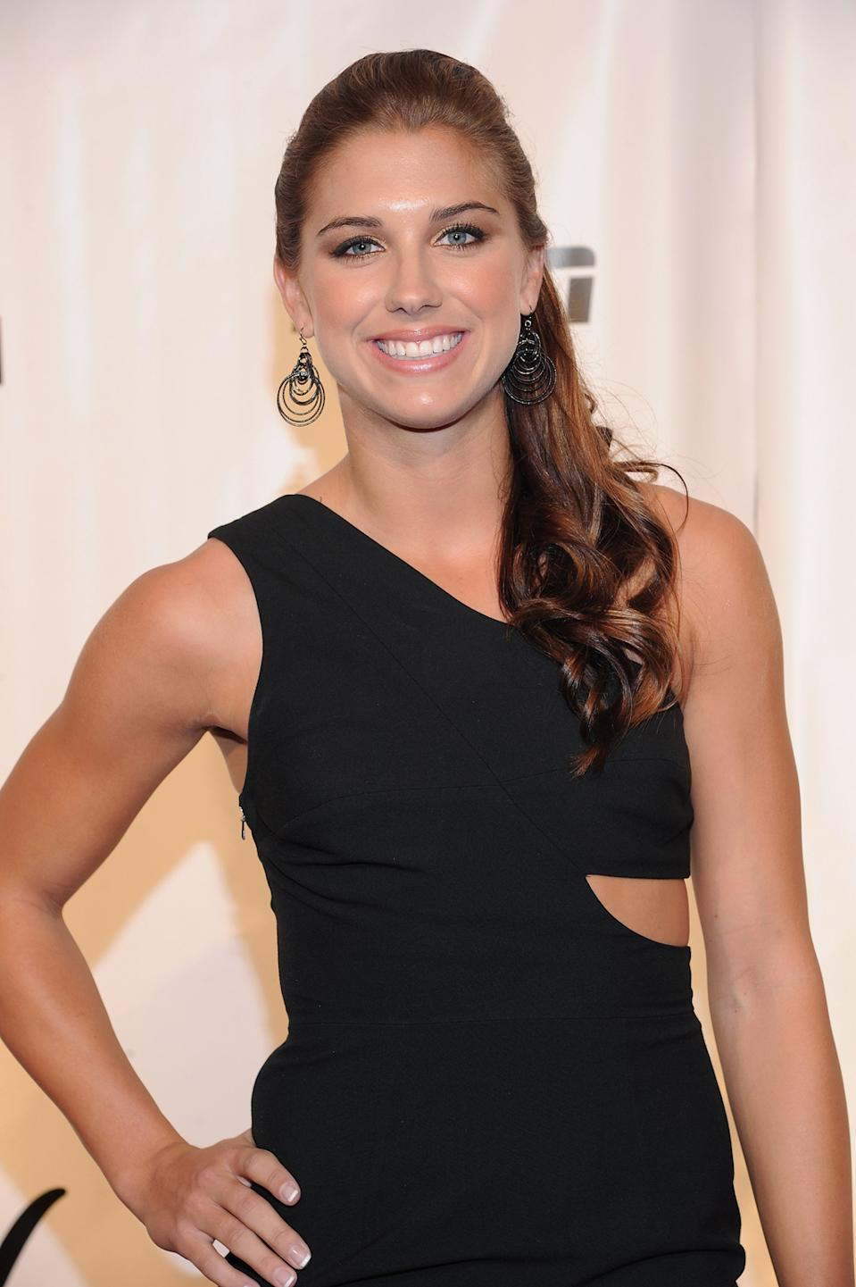 """<b>Alex Morgan</b><br> U.S. soccer champ Alex Morgan is brains and beauty, having graduated early from the University of California, Berkeley. She went onto be the youngest player on USA's roster at the 2011 FIFA Women's World Cup and scored her team's first goal at the London Olympics. Check out <a href=""""http://sports.yahoo.com/photos/olympics-soccer-star-alex-morgan-slideshow/"""" data-ylk=""""slk:more photos of Alex;outcm:mb_qualified_link;_E:mb_qualified_link;ct:story;"""" class=""""link rapid-noclick-resp yahoo-link"""">more photos of Alex</a> here. (Photo by Jason Kempin/Getty Images)"""