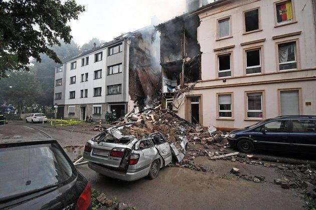 A car is covered by debris of a house that has exploded in the night in Wuppertal, western Germany.