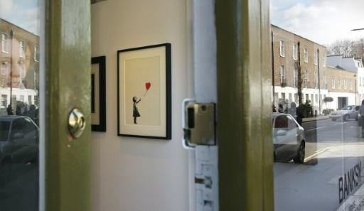 Banksy artwork shreds itself after sale in UK
