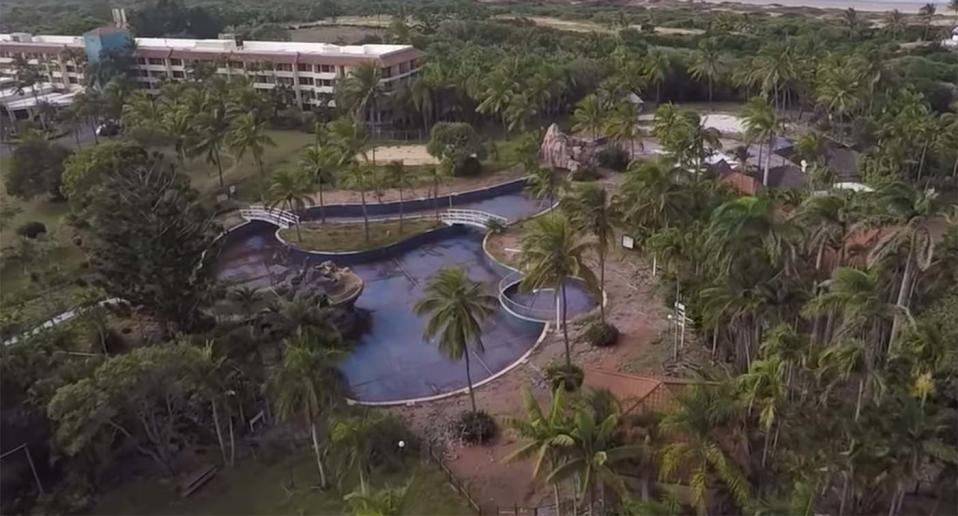 An aerial view of the Capricorn Resort's crumbling swimming pool and neglected landscaping.