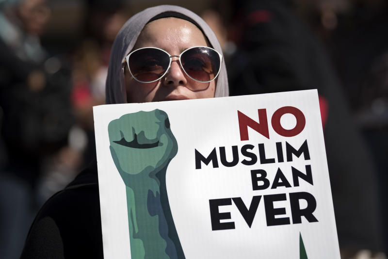 An activist in Los Angeles holds a sign on Oct. 15 during a protest against President Donald Trump's travel ban. (NurPhoto via Getty Images)