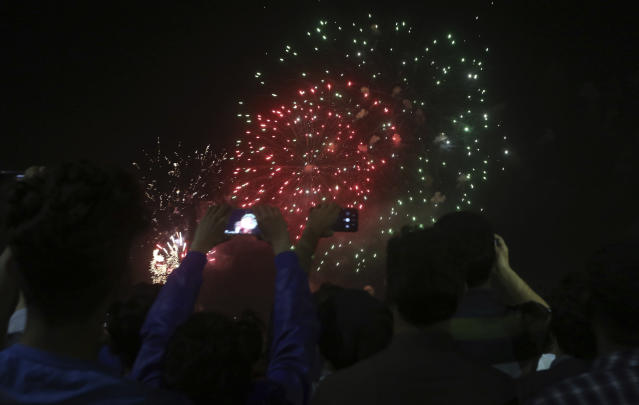 People take watchf firework display on the occasion of the Pakistan National Day in Lahore, Pakistan, Friday, March 22, 2019. (AP Photo/K.M. Chaudary)