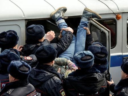 Police officers detain an opposition supporter during a rally in Vladivostok, Russia. REUTERS/Yuri Maltsev