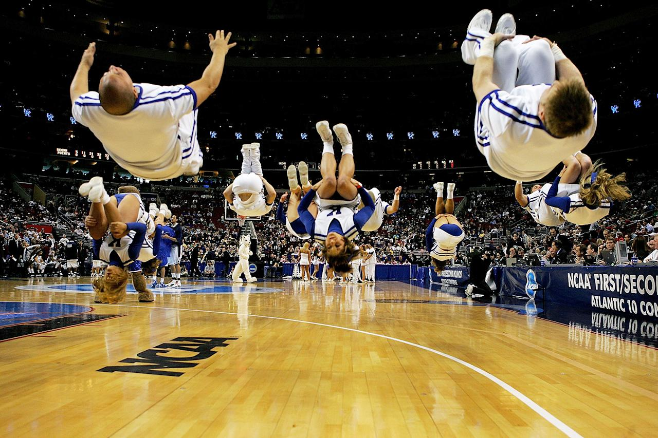 Kentucky Wildcat cheerleaders perform for the game against the Connecticut Huskies during the Second Round of the 2006 NCAA Men's Basketball Tournament on March 19, 2006 at the Wachovia Center in Philadelphia, Pennsylvania.  (Photo by Jim McIsaac/Getty Images)