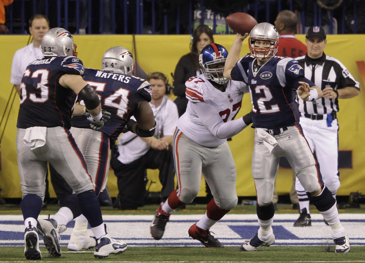 New England Patriots quarterback Tom Brady throws a pass as New York Giants defensive tackle Linval Joseph rushes during the second half of the NFL Super Bowl XLVI football game, Sunday, Feb. 5, 2012, in Indianapolis. (AP Photo/Michael Conroy)
