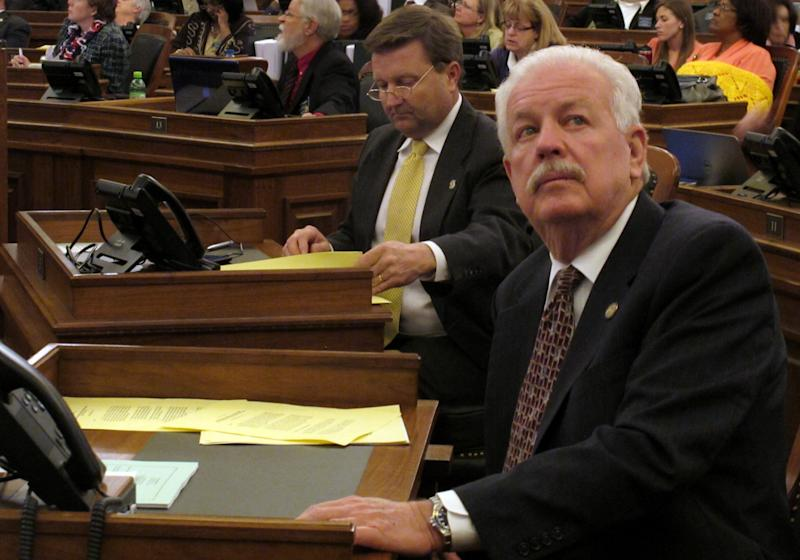 Kansas House Speaker Ray Merrick, right, a Stilwell Republican, watches the chamber's electronic tally board as it approves a sweeping anti-abortion bill, Friday, April 5, 2013, at the Statehouse, in Topeka, Kan. To Merrick's left is Majority Leader Jene Vickrey, a Louisburg Republican. (AP Photo/John Hanna)