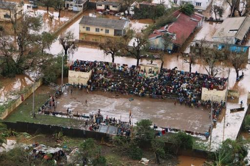 Stranded: Survivors of Cyclone Idai gather at the basketball stadium in Buzi, central Mozambique -- a relative haven from the flood water