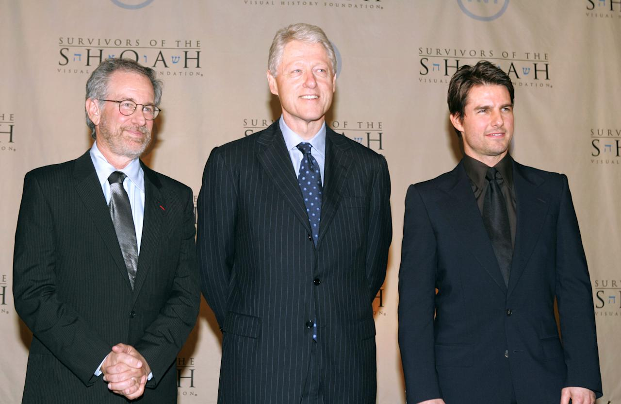 Director Steven Spielberg, former President Bill Clinton and actor Tom Cruise attend the 5th Annual Ambassadors for Humanity Dinner Honoring President Clinton to support the Survivors of the Shoah Visual History Foundation held at the Amblin theatre Universal Studios on February 17, 2005 in Los Angeles, California. (Photo by Frazer Harrison/Getty Images)