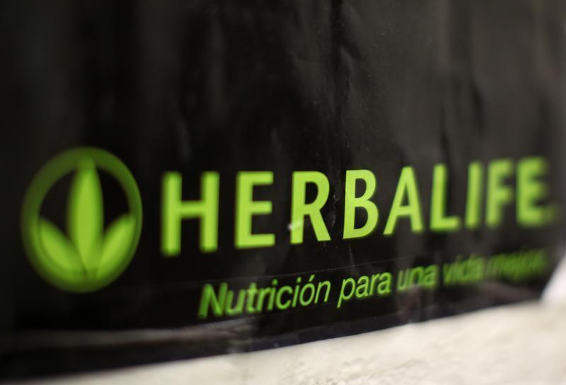 An Herbalife logo is shown on a poster at a clinic in the Mission District in San Francisco