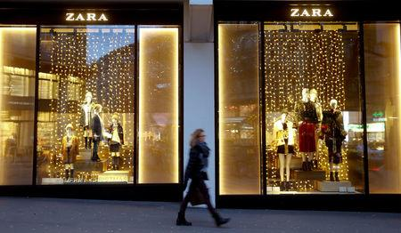 FILE PHOTO: Christmas decorations are seen in the windows of a Zara clothing store at the Bahnhofstrasse shopping street in Zurich, Switzerland November 27, 2017.  REUTERS/Arnd Wiegmann/File Photo