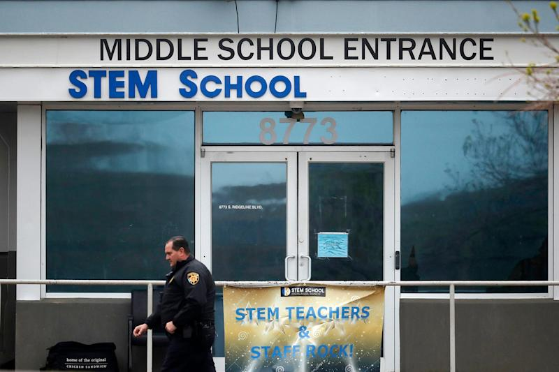 FILE - In this May 8, 2019 file photo, a Douglas County, Colo., Sheriff's deputy walks past the doors of the STEM Highlands Ranch school in Highlands Ranch, Colo. The younger of two students charged in a school shooting in suburban Denver that killed a classmate has pleaded guilty. Prosecutors say 16-year-old Alec McKinney pleaded guilty on Friday, Feb. 7, 2020 to 17 felonies, including a first-degree murder charge. In December, a judge ruled that McKinney would be prosecuted as an adult in the May 7 shooting at STEM School Highlands Ranch that killed 18-year-old Kendrick Castillo. Devon Erickson has pleaded not guilty to the same charges McKinney faced in the shooting.(AP Photo/David Zalubowski, File) ORG XMIT: LA505