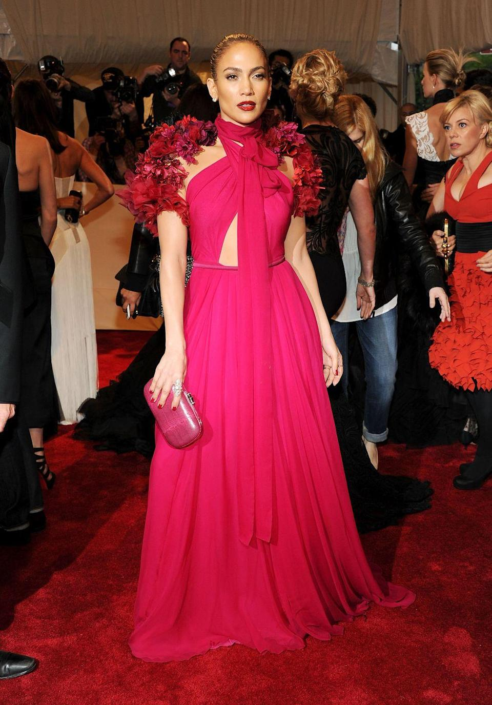 <p>In red Gucci at the 2011 Met Gala honouring Alexander McQueen.</p>