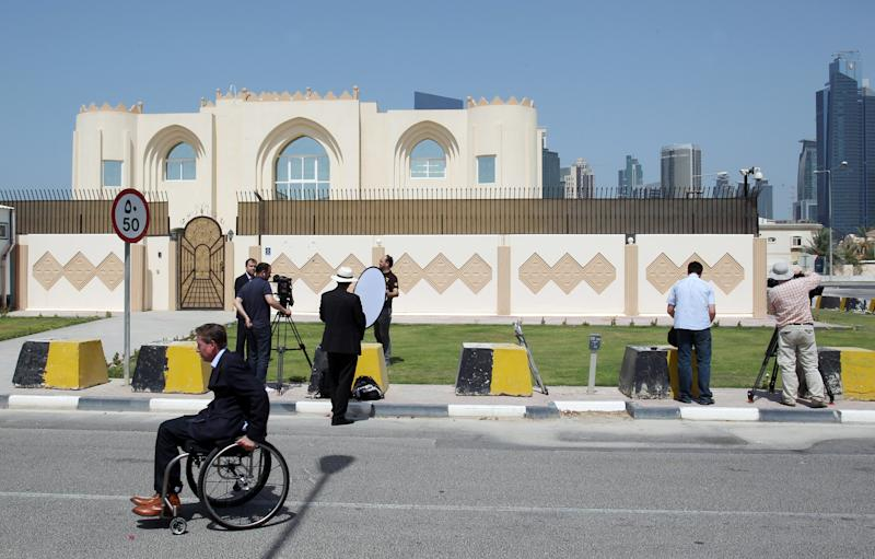 "This photo taken on Thursday, June 20, 2013 shows the new office of the Afghan Taliban in Doha, Qatar after the opening of the office several days ago. The United States on Thursday welcomed Qatar's decision to take down a sign that cast the Taliban's new office in Doha as a rival Afghan embassy saying the militant group can't represent itself ""as an emirate, government or sovereign."" (AP Photo/Osama Faisal)"