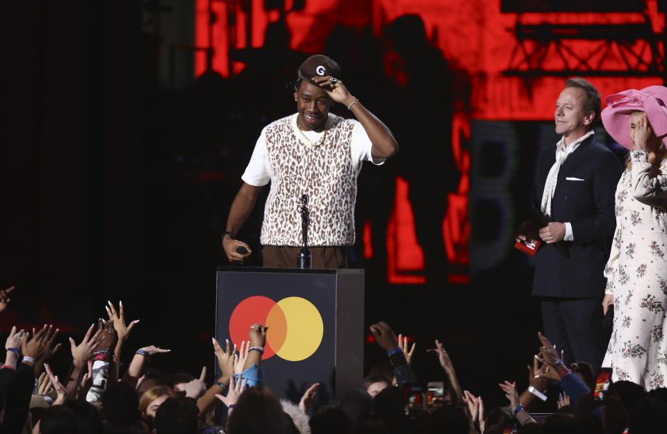 Tyler, the Creator accepts his award for International Male Solo Artist on stage at the Brit Awards 2020 in London, Tuesday, Feb. 18, 2020. (Photo by Joel C Ryan/Invision/AP)