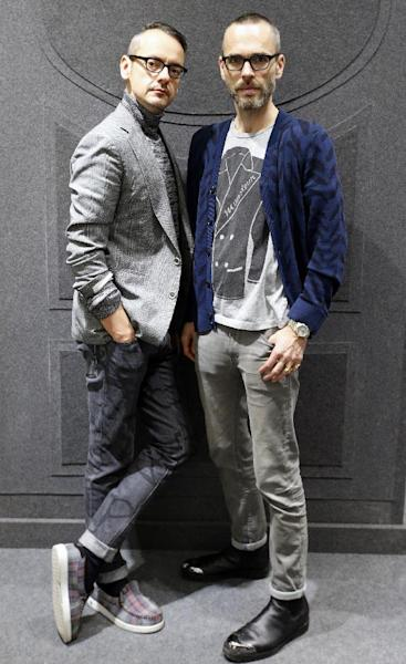 Netherlands' fashion designers Rolf Snoeren, left, and Viktor Horsting pose in their new Viktor and Rolf shop in Paris, Wednesday, Dec. 11, 2013. Viktor&Rolf, the Amsterdam-based avant-garde fashion house, opens its first ever flagship boutique in France in Paris. (AP Photo/Francois Mori)