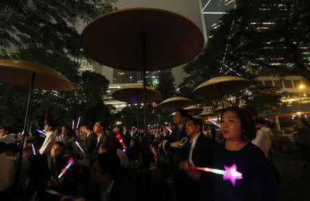 People wave luminous sticks as they take part in an anti-Occupy Central rally at Hong Kong's financial Central district November 4, 2014. REUTERS/Bobby Yip