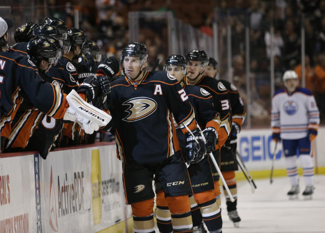 Anaheim Ducks' Francois Beauchemin, center, celebrates his goal with teammates during the first period of an NHL hockey game against the Edmonton Oilers Wednesday, April 1, 2015, in Anaheim, Calif. (AP Photo/Jae C. Hong)