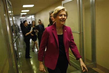 U.S. Senator Warren departs after the Senate passed a spending bill to avoid a government shutdown, sending the issue back to the House of Representatives, at the U.S. Capitol in Washington