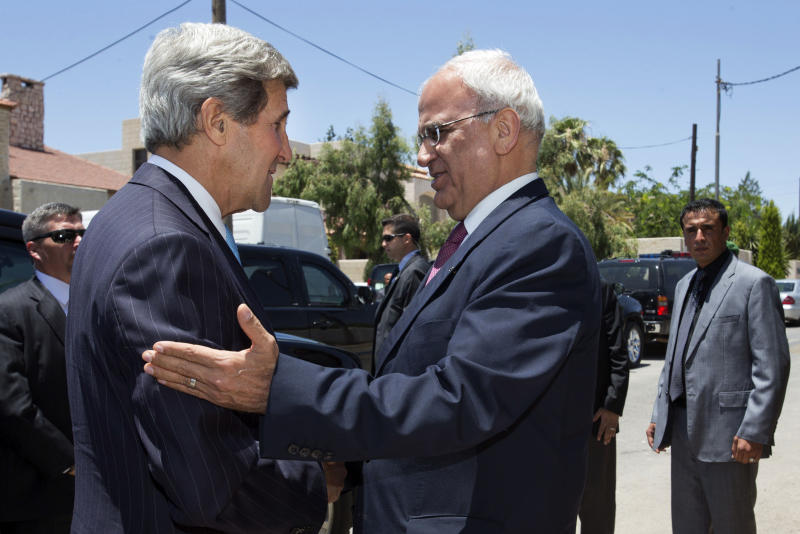U.S. Secretary of State John Kerry, left, is greeted by Saeb Erekat, Palestinian negotiator, as Kerry arrives for a meeting with Palestinian President Mahmoud Abbas, not pictured, in Amman, Jordan, on Friday, June 28, 2013. It is Kerry's fifth visit to the region since becoming secretary of state in February to try to restart peace talks between the Israelis and Palestinians, which broke down in 2008. (AP Photo/Jacquelyn Martin, Pool)