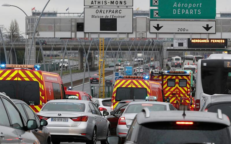 Emergency vehicles arrive Orly airport southern terminal in Paris - Credit: Reuters