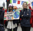 Climate protestors block a road leading to Britain's Parliament in central London Monday, Oct. 7, 2019, in an attempt to disrupt the heart of government. Activists with the Extinction Rebellion movement blocked major roads in London, Berlin and Amsterdam on Monday at the beginning of what was billed as a wide-ranging series of protests demanding new climate policies. (AP Photo/Matt Dunham)