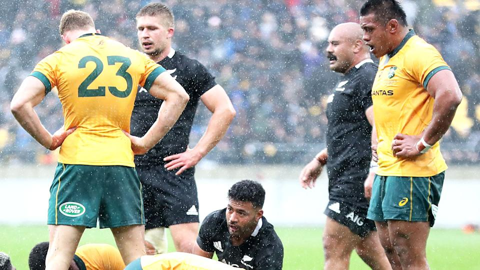 Wallabies and All Blacks players, pictured here after the full-time whistle in the opening Bledisloe Cup clash.