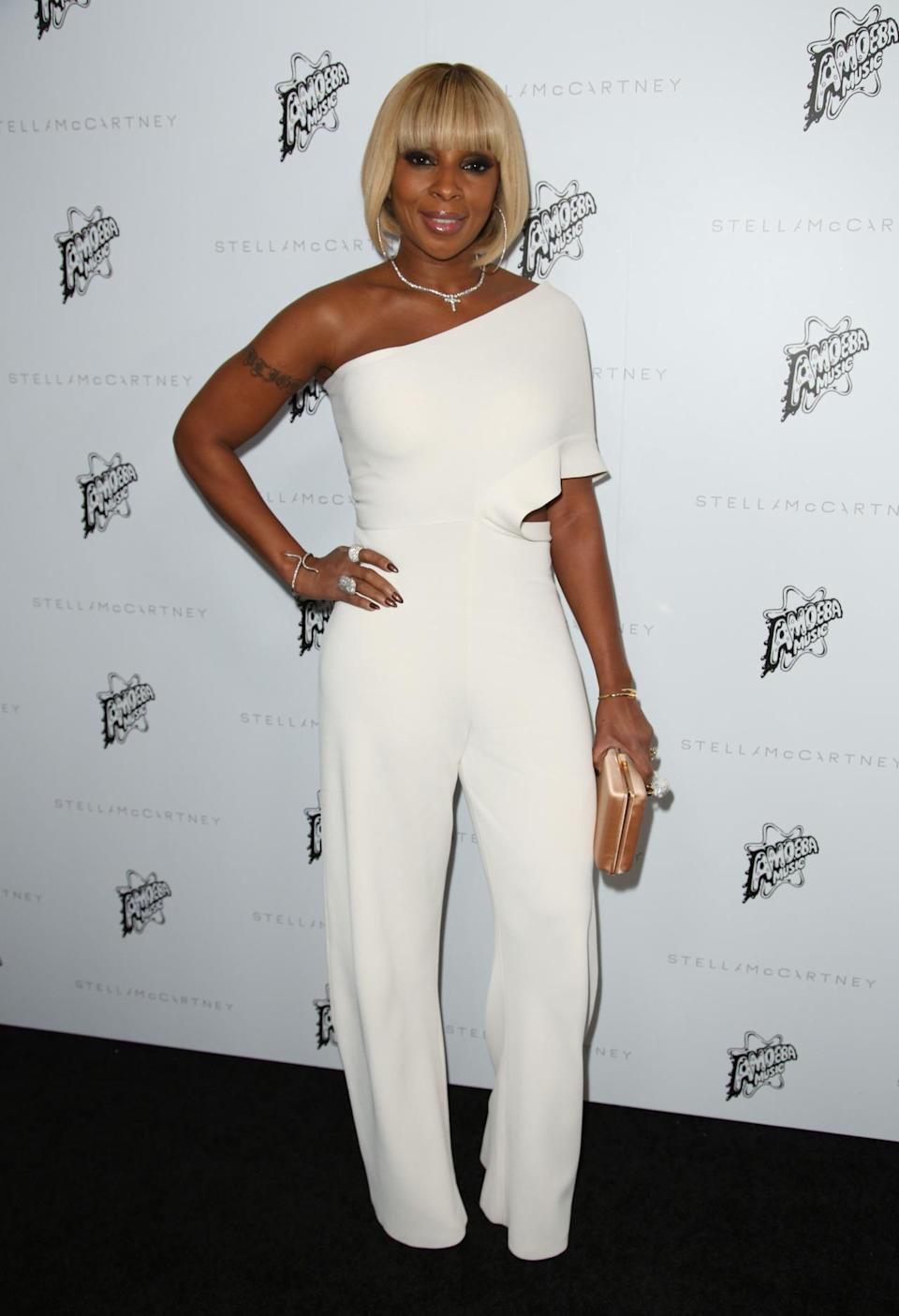 <p>Mary J Blige slayed in this crisp white jumpsuit.<i> [Photo: Rex]</i></p>