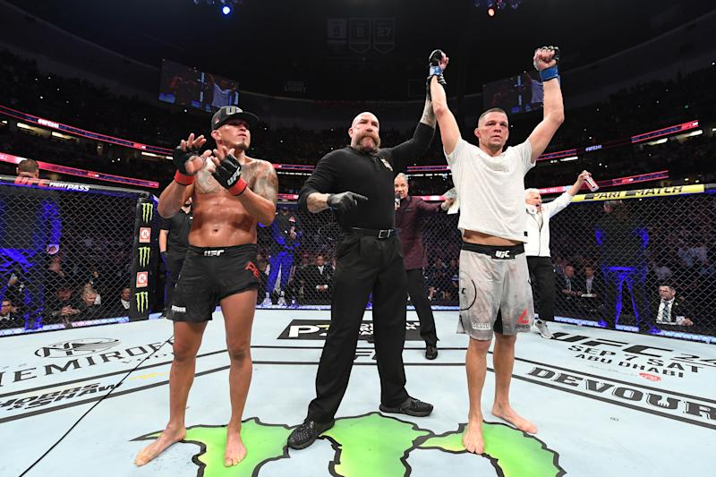 ANAHEIM, CALIFORNIA - AUGUST 17: (R-L) Nate Diaz celebrates his victory over Anthony Pettis in their welterweight bout during the UFC 241 event at the Honda Center on August 17, 2019 in Anaheim, California. (Photo by Josh Hedges/Zuffa LLC/Zuffa LLC via Getty Images)