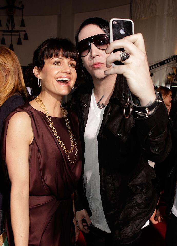 """A Hollywood horror premiere wouldn't be complete without shock rocker <a href=""""http://movies.yahoo.com/movie/contributor/1800303496"""">Marilyn Manson</a>, who posed for pictures with fellow slasher fan <a href=""""http://movies.yahoo.com/movie/contributor/1800024683"""">Carla Gugino</a>."""