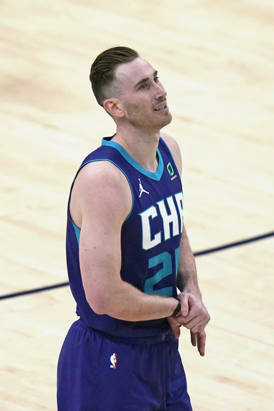 Charlotte Hornets forward Gordon Hayward (20) walks off the court after injuring his right wrist in the second half during an NBA basketball game against the Utah Jazz Monday, Feb. 22, 2021, in Salt Lake City. (AP Photo/Rick Bowmer)