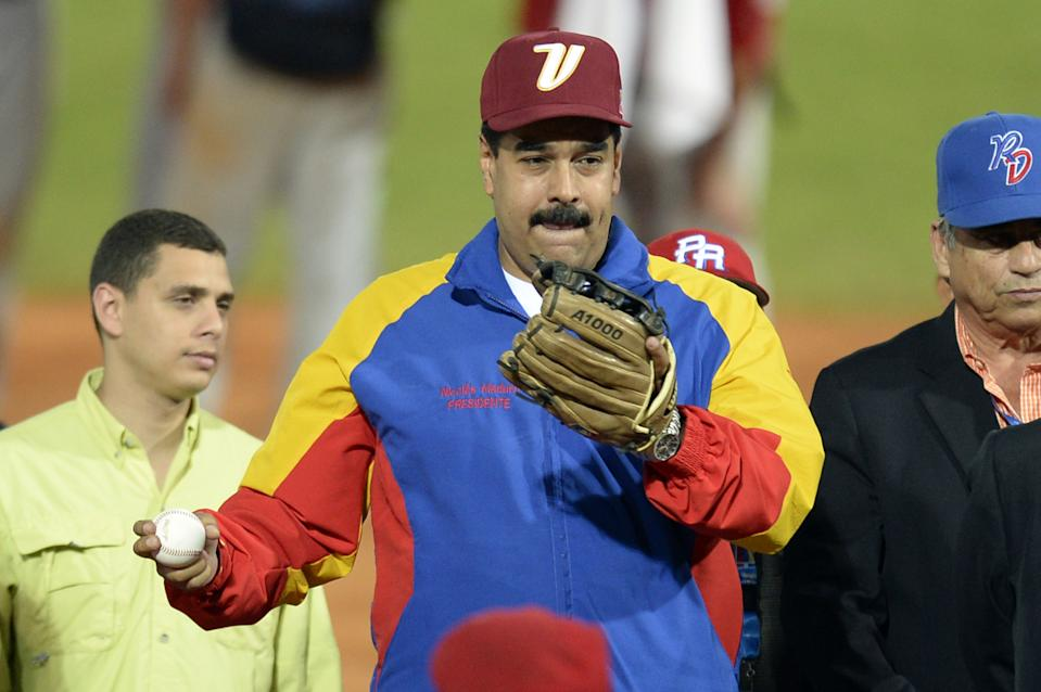 Venezuelan President Nicolas Maduro attends the opening ceremony of the 2014 Caribbean baseball series, on February 1, 2014, in Porlamar city, Nueva Esparta state, Margarita Island, Venezuela . AFP PHOTO/LEO RAMIREZ / AFP PHOTO / Leo RAMIREZ        (Photo credit should read LEO RAMIREZ/AFP via Getty Images)