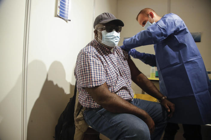 A man receives a Pfizer COVID-19 vaccine at a new vaccination center run by the Paris' fire brigade in Paris, Thursday, May 6, 2021. France joined the United States on Thursday in supporting an easing of patent and other protection on Covid-19 vaccines that could help poorer countries get more doses and speed the en of the pandemic. (AP Photo/Michel Euler)