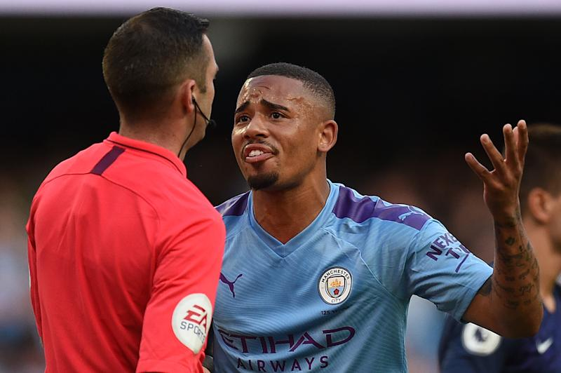 Manchester City's Brazilian striker Gabriel Jesus (R) remonstrates with English referee Michael Oliver after his goal was dissallowed following a VAR decision during the English Premier League football match between Manchester City and Tottenham Hotspur at the Etihad Stadium in Manchester, north west England, on August 17, 2019. - The match ended in a draw at 2-2. (Photo by Oli SCARFF / AFP) / RESTRICTED TO EDITORIAL USE. No use with unauthorized audio, video, data, fixture lists, club/league logos or 'live' services. Online in-match use limited to 120 images. An additional 40 images may be used in extra time. No video emulation. Social media in-match use limited to 120 images. An additional 40 images may be used in extra time. No use in betting publications, games or single club/league/player publications. / (Photo credit should read OLI SCARFF/AFP/Getty Images)