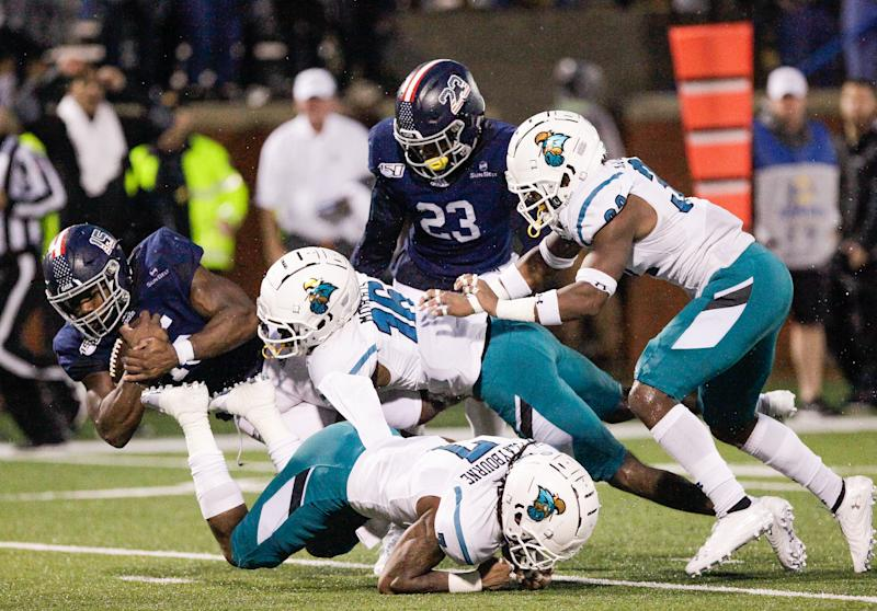 STATESBORO, GA - OCTOBER 19: J.D. King #15 of the Georgia Southern Eagles is brought down after a big gain in overtime by Jordan Morris #16 of the Coastal Carolina Chanticleers at Paulson Stadium on October 19, 2019 in Statesboro, Georgia. (Photo by Chris Thelen/Getty Images)