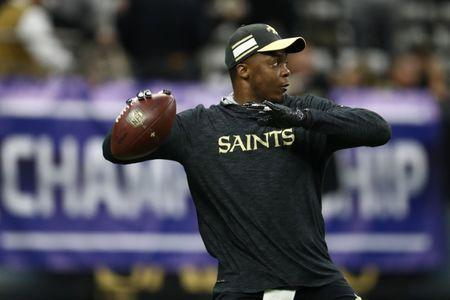 Jan 20, 2019; New Orleans, LA, USA; New Orleans Saints quarterback Teddy Bridgewater (5) throws a pass during warmups before the NFC Championship game against the Los Angeles Rams at Mercedes-Benz Superdome. Mandatory Credit: Matthew Emmons-USA TODAY Sports