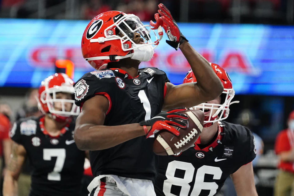 Georgia wide receiver George Pickens (1) celebrates his touchdown catch against Cincinnati during the first half of the Peach Bowl NCAA college football game, Friday, Jan. 1, 2021, in Atlanta. (AP Photo/Brynn Anderson)