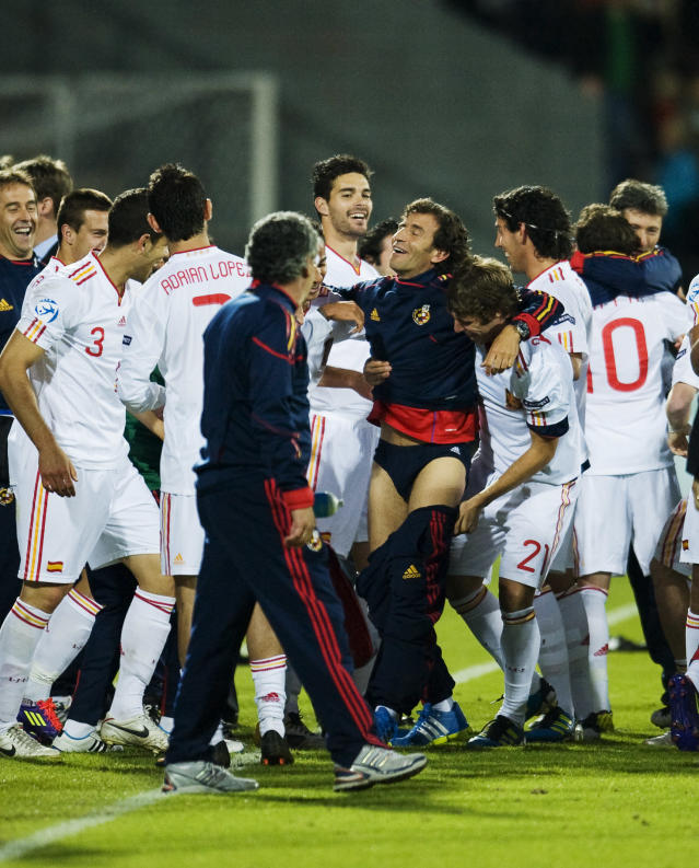 Spanish players celebrate their 2-0 victory with their coach Luis Milla during the UEFA Under-21 European Championship football final match Spain vs Switzerland at the Aarhus Stadium, on June 25, 2011. Spain won the final. AFP PHOTO/JONATHAN NACKSTRAND (Photo credit should read JONATHAN NACKSTRAND/AFP/Getty Images)