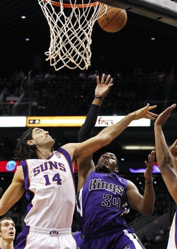 Sacramento Kings' Jason Thompson (34) gets off a shot over Phoenix Suns' Luis Scola (14), of Argentina, during the first half of an NBA preseason basketball game, Monday, Oct. 22, 2012, in Phoenix. (AP Photo/Ross D. Franklin)