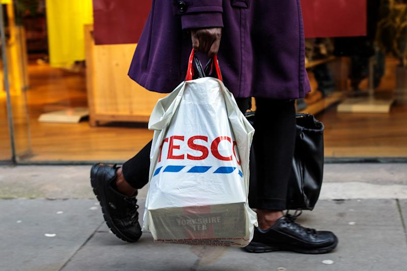 LONDON, ENGLAND - DECEMBER 27: A plastic Tesco bag is carried by a shopper on December 27, 2018 in London, England. England's current 5-pence fee for plastic shopping bags could double in 2020, under plans announced by Environment Secretary Michael Gove. The levy would also apply to smaller retailers currently exempted from the law. (Photo by Jack Taylor/Getty Images)