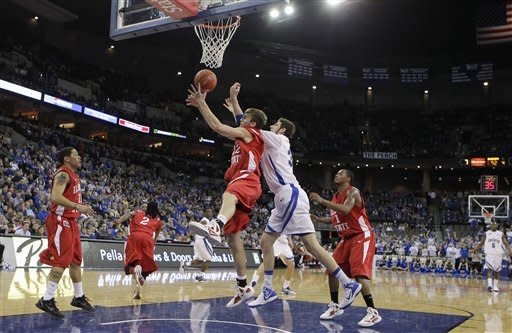 Illinois State's Jon Ekey, center left, and Creighton's Will Artino go for a rebound, with Illinois State's Nic Moore, left, and Tyler Brown, right, looking on in the second half of an NCAA college basketball game in Omaha, Neb., Wednesday, Feb. 1, 2012. Creighton won 102-74. (AP Photo/Nati Harnik)