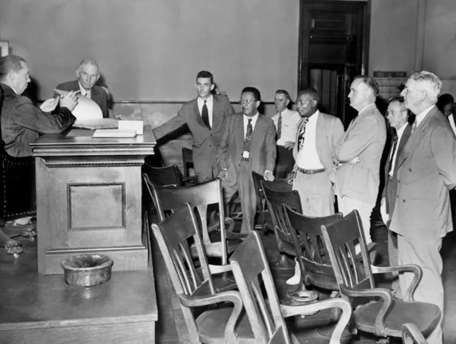 Representatives of the state and defense stand expectantly July, 4, 1946, as Judge Joe M. Ingram, left, prepares to hand down one of several decisions in connection with the February racial uprising in Columbia, Tenn.