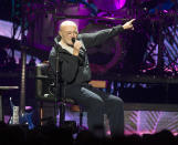 "FILE - Phil Collins performs during his ""Not Dead Yet Tour"" in Philadelphia on Oct. 8, 2018. Collins is among several musicians who are objecting to their songs being used at President Donald Trump's campaign rallies. (Photo by Owen Sweeney/Invision/AP, File)"