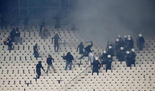 Soccer Football - Greek Cup Final - AEK Athens vs PAOK Salonika - Athens Olympic Stadium, Athens, Greece - May 12, 2018 Police and fans clash in the stands REUTERS/Alkis Konstantinidis