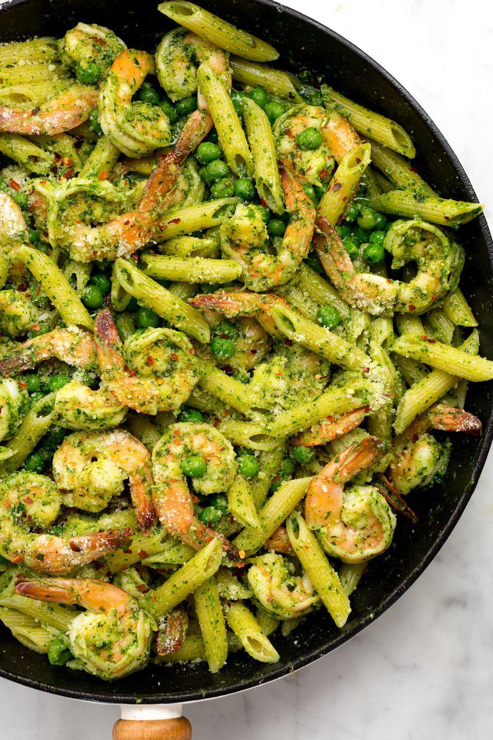 """<p>Pesto nuts will love this fresh spring combo of spinach, basil, and sweet peas. </p><p>Get the recipe from <a href=""""https://www.delish.com/cooking/recipe-ideas/recipes/a46530/spinach-pesto-penne-with-shrimp-and-peas-recipe/"""" rel=""""nofollow noopener"""" target=""""_blank"""" data-ylk=""""slk:Delish"""" class=""""link rapid-noclick-resp"""">Delish</a>.</p>"""