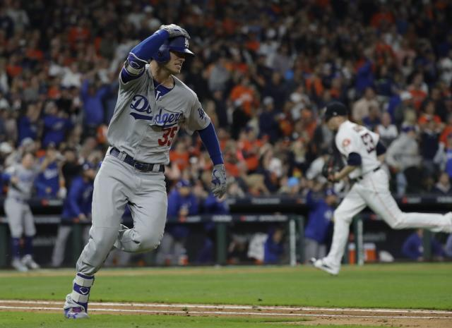 Los Angeles Dodgers' Cody Bellinger reacts after hitting an RBI double during the ninth inning of Game 4 of the World Series. (AP)