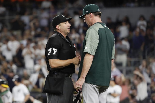 Home plate umpire Jim Reynolds, left, talks to Oakland Athletics manager Bob Melvin during the fourth inning of the team's baseball game against the New York Yankees on Friday, Aug. 30, 2019, in New York. (AP Photo/Frank Franklin II)