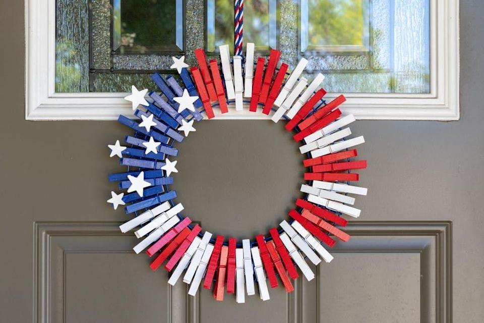 """<p>This wreath is super-easy to assemble as its made from clothespins, which get a patriotic makeover thanks to a little spray paint. </p><p><strong>Get the tutorial at <a href=""""https://thekrazycouponlady.com/tips/diy/diy-fourth-of-july-clothespin-wreath"""" rel=""""nofollow noopener"""" target=""""_blank"""" data-ylk=""""slk:The Krazy Coupon Lady"""" class=""""link rapid-noclick-resp"""">The Krazy Coupon Lady</a>. </strong></p><p><strong><a class=""""link rapid-noclick-resp"""" href=""""https://www.amazon.com/JABINCO-Pack-Wooden-Clothespins-About/dp/B0852TXHZG/ref=sr_1_2?dchild=1&keywords=clothespins&qid=1622040206&sr=8-2&tag=syn-yahoo-20&ascsubtag=%5Bartid%7C10050.g.4464%5Bsrc%7Cyahoo-us"""" rel=""""nofollow noopener"""" target=""""_blank"""" data-ylk=""""slk:SHOP CLOTHESPINS"""">SHOP CLOTHESPINS</a><br></strong></p>"""